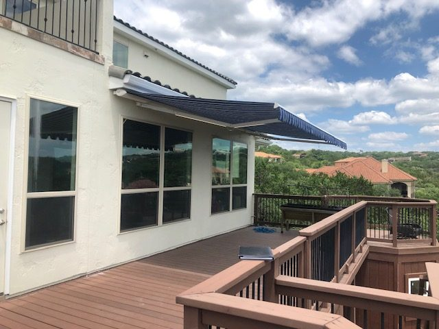 blue retractable awning over deck